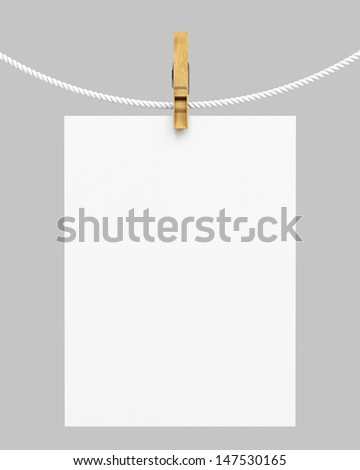 white paper hanging on rope with clothespin - stock photo