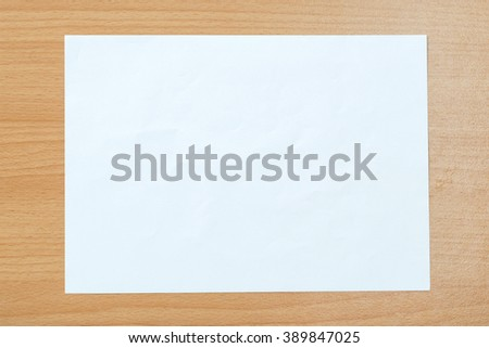 White paper isolated on a wooden floor.