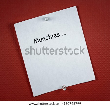 White paper menu with copy space under the word 'MUNCHIES...' , on deep red background. The color red, like marijuana, has been proven to make people want to eat more.
