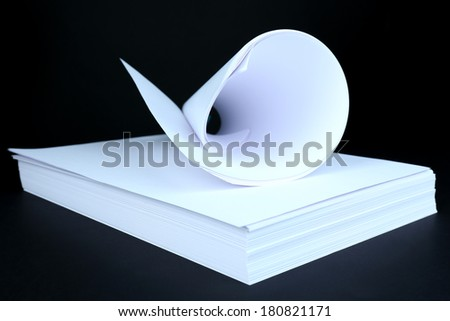 White paper on black background close-up - stock photo