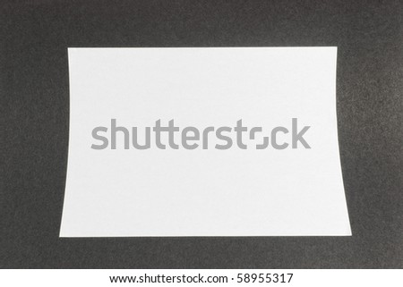 white paper on black textured background