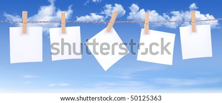white paper on blue sky background - stock photo