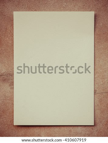 White paper on Gray background isolated,gray cement background.White Paper on the cement floor , dark sepia tone.White paper on cement table.Blank flyer poster isolated on sepia to replace your design - stock photo