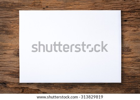 white paper on old wood table  - stock photo