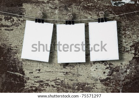 White paper on the background of the old wall - stock photo