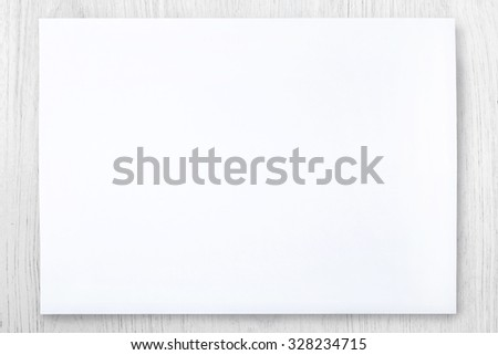 white paper on white wood table  - stock photo