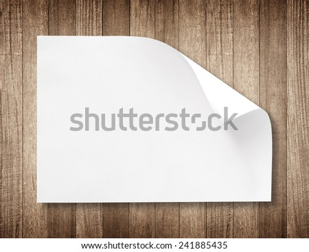 white paper on wood background and shadow - stock photo