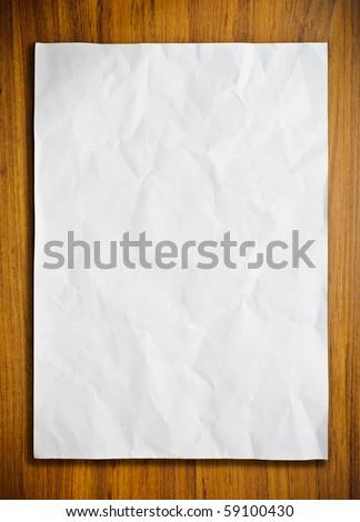 White paper on wood floor - stock photo