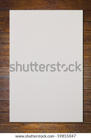 White paper on wood wall - stock photo