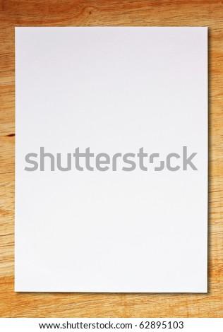 white paper on wooden floor - stock photo