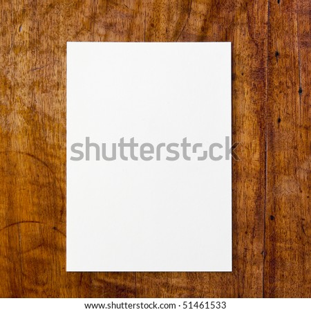 White paper pad on antique or aged wooden table