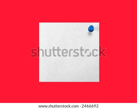 White paper pinned to a red background with a blue pushpin. - stock photo