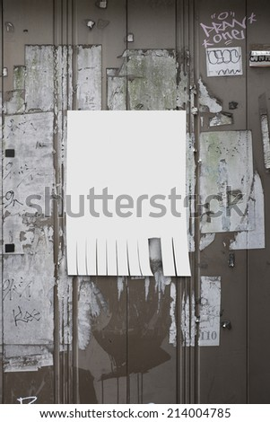 white paper posted on old billboard and marked with your own message - stock photo