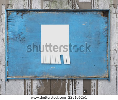 white paper posted on old blue wooden billboard and marked with your own message - stock photo