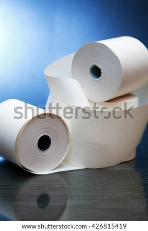 White paper rolls with reflection on dark background