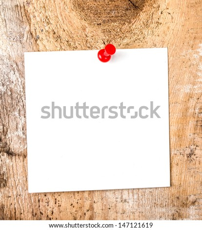 White paper sticky note reminder With red Push Pin on wooden old background - stock photo
