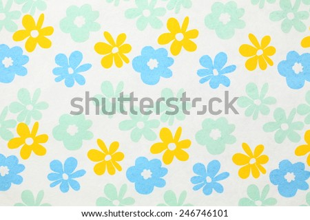 White paper with red, blue and green flowers for background - stock photo