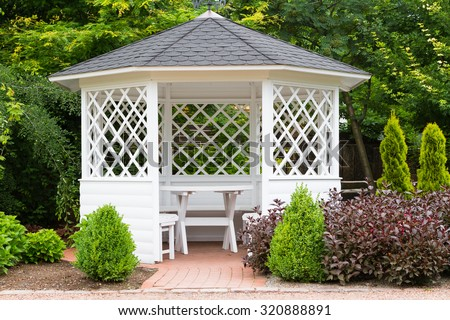 White pavilion in the garden. - stock photo