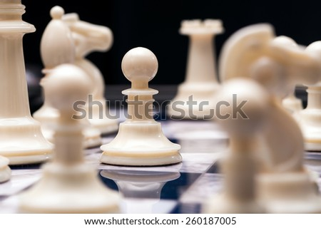 White Pawn and chess - stock photo