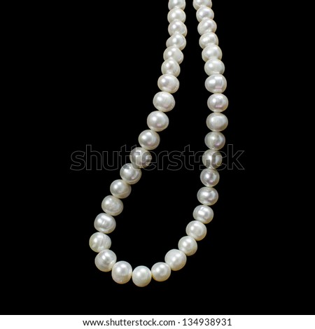 White Pearl Necklace on black background - stock photo