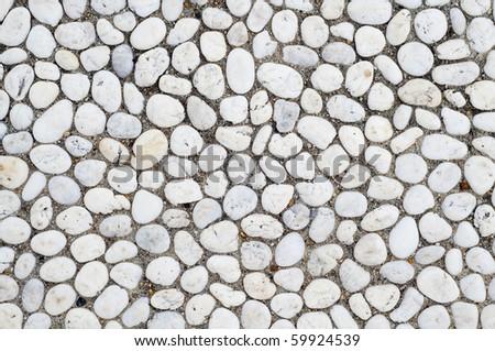 white pebble stone on ground texture - stock photo