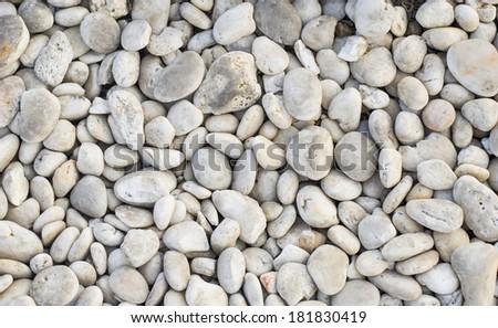 white pebble stone on the floor - stock photo