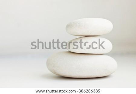 white pebbles pile white background pure simplicity empty soft focus - stock photo