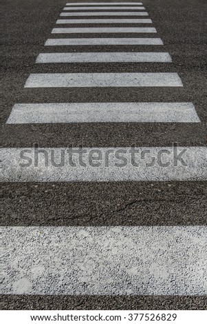white pedestrian strips on asphalt - stock photo