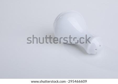 white pepper bottle on white background - stock photo