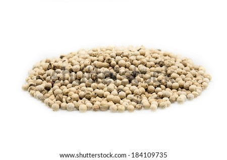 White pepper seeds on a white background