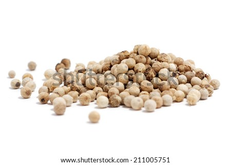 white peppercorn on white background - stock photo