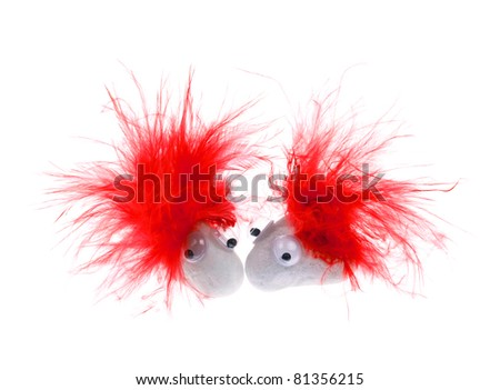 White Pet Rocks with Googly Eyes and Red Feather Hair - stock photo