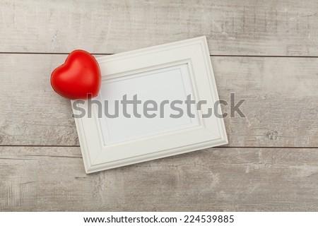 White photo frame on wood table  - stock photo