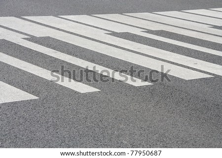 "White ""piano"" painted pedestrian crossing on the road in Warsaw, Poland. Abstract musical background. - stock photo"