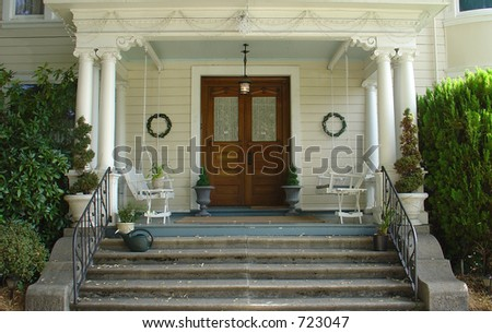 White picket entry gate in front of a early 1900's home. Pro-mist filter gives a slight glowing nostalgic quality to the image. - stock photo