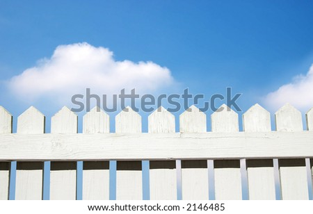 White picket fence and sky - stock photo