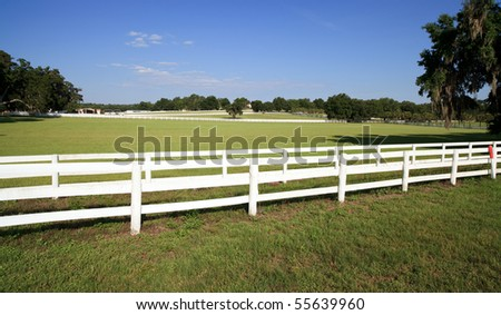 White Picket Fence on a Farm/Ranch - stock photo