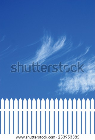 white picket  fence with a blue sky - stock photo