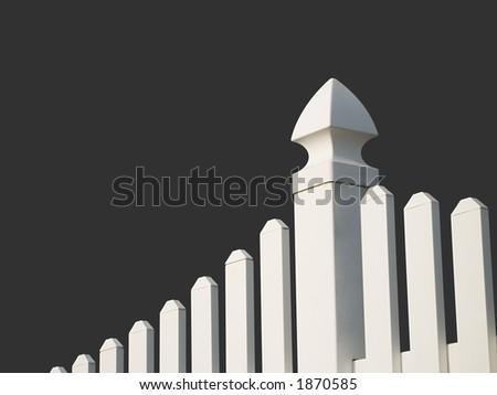 White picket fence with dark background. - stock photo