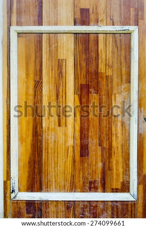 white picture frame on wooden background - stock photo