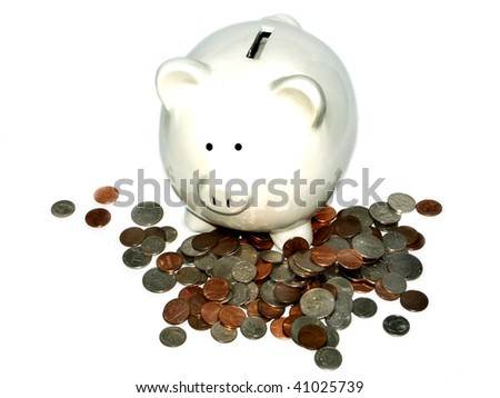 White piggy bank with loose change - stock photo