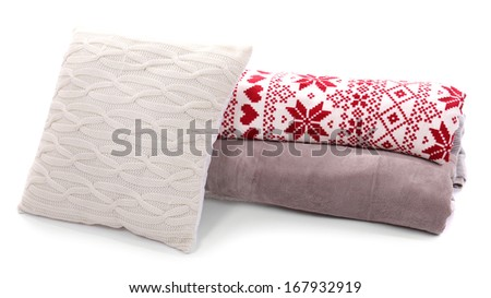 White pillow and colorful plaids isolated on white