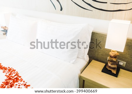 White pillow and Red rose flower on bed decoration in bedroom interior - Vintage Light Filter