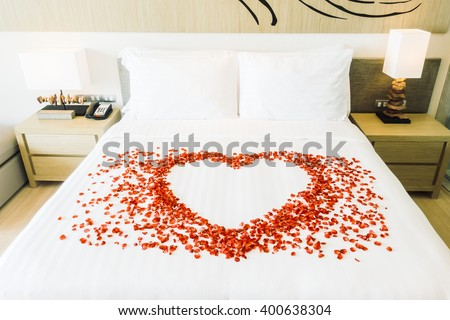 White Pillow And Red Rose Flower On Bed Decoration In Bedroom Interior    Vintage Light Filter