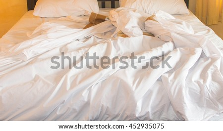 white pillow on bed and with wrinkle messy blanket in bedroom - stock photo