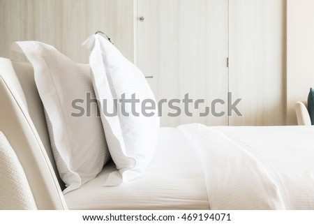White pillow on bed decoration in bedroom interior