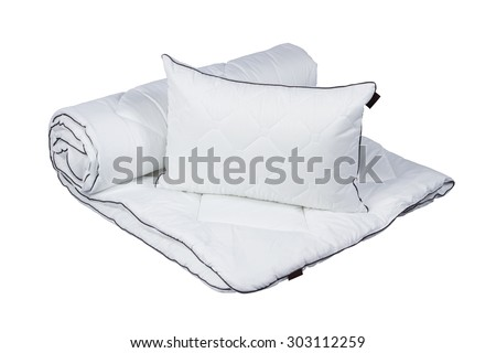 White pillow on blanket isolated - stock photo