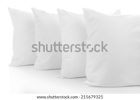 White pillows isolated on white - stock photo