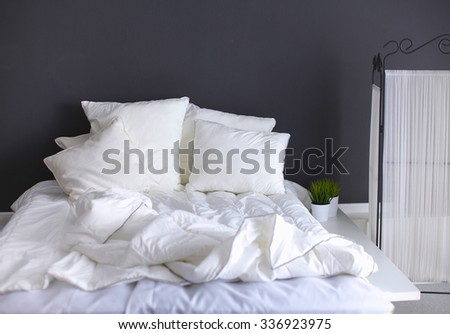 White pillows on a bed - stock photo