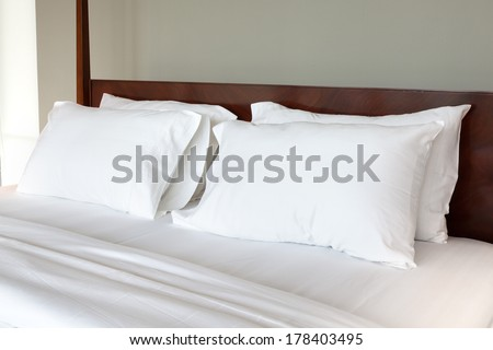 White pillows on a bed Comfortable soft pillows on the bed - stock photo